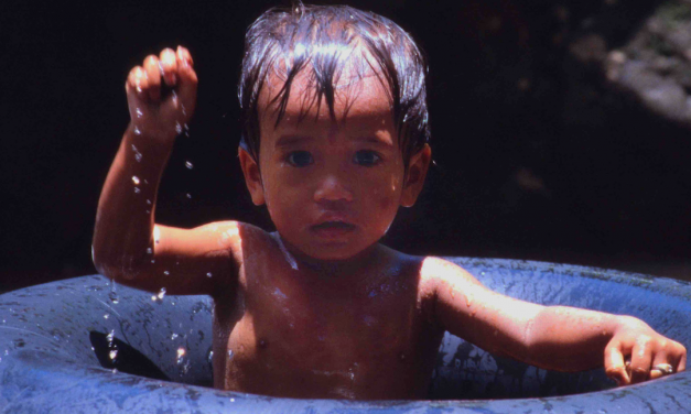 A Cambodian Child in Phnom Kulen Waterfalls